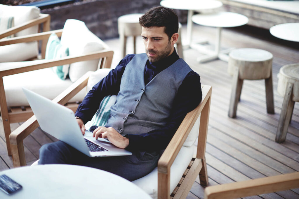 rich man with laptop